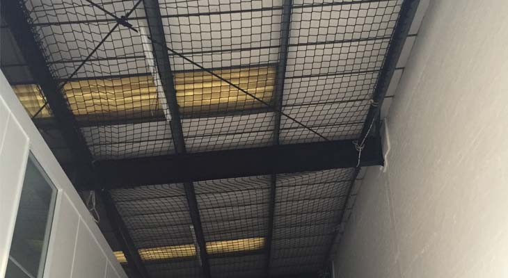 Internal safety netting installed to warehouse unit
