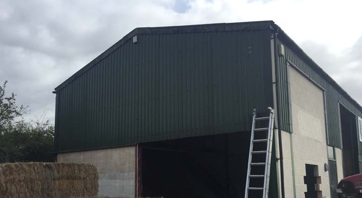 Before view of gable end with roller shutter door entrance