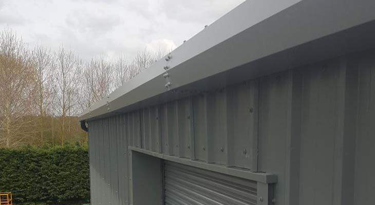 Eaves level view of new trim line gutter installation