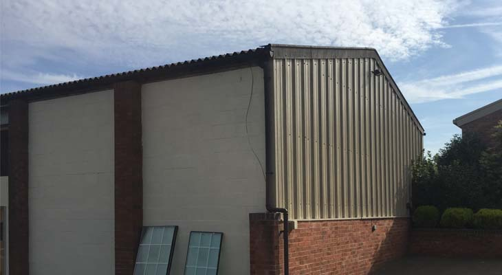Gable end cladded in single skin metal sheets