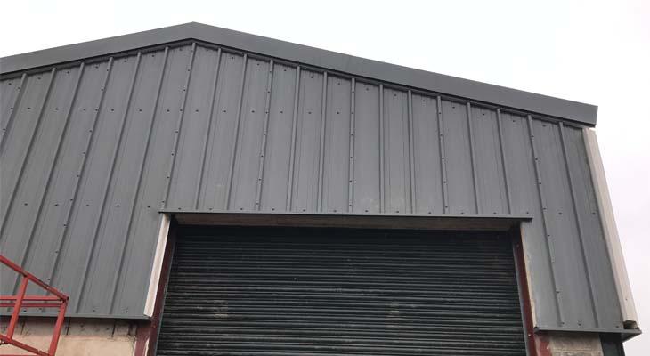 Kingspan RW1000 wall cladding installed around roller shutter door