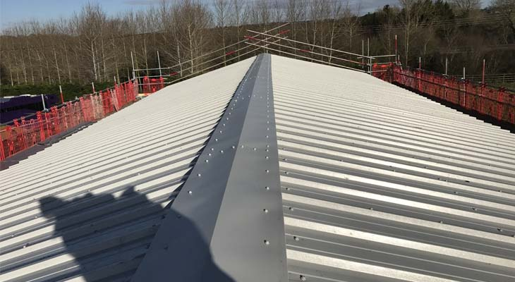 Newly installed Kingspan RW1000 composite roofing with ridge flashing