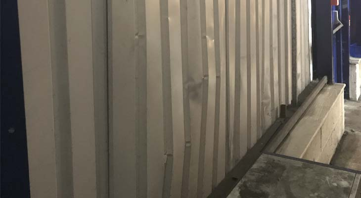 Internal wall cladding sheet pushed inwards from impact damage