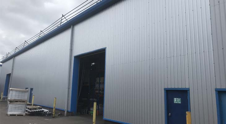 View along the rear elevation with new press brake cladding sheets installed
