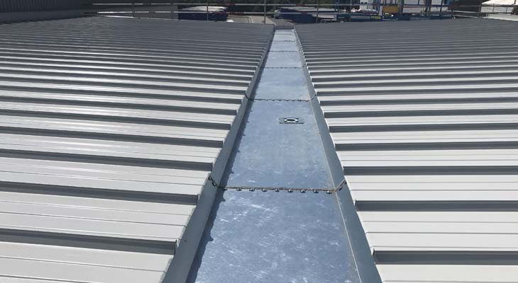 New galvanised valley gutter installed to canopy roofing