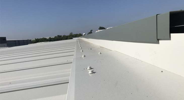 Ridge flashing being installed encapsulating front elevation upstand