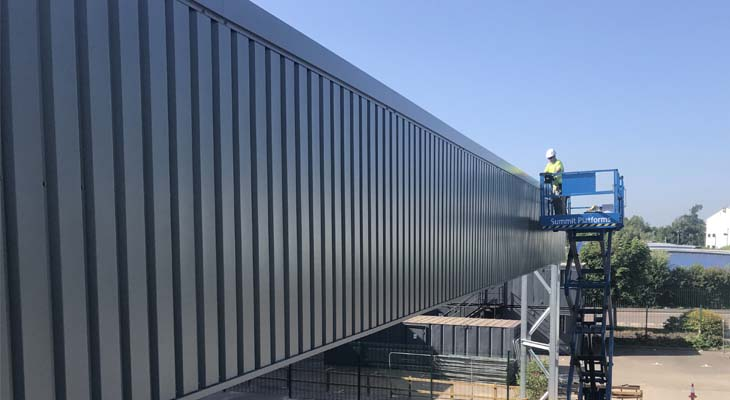 Works undertaken to canopy wall cladding from scissor lift